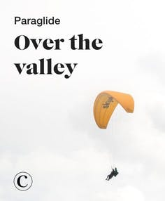 Paraglide over the valley