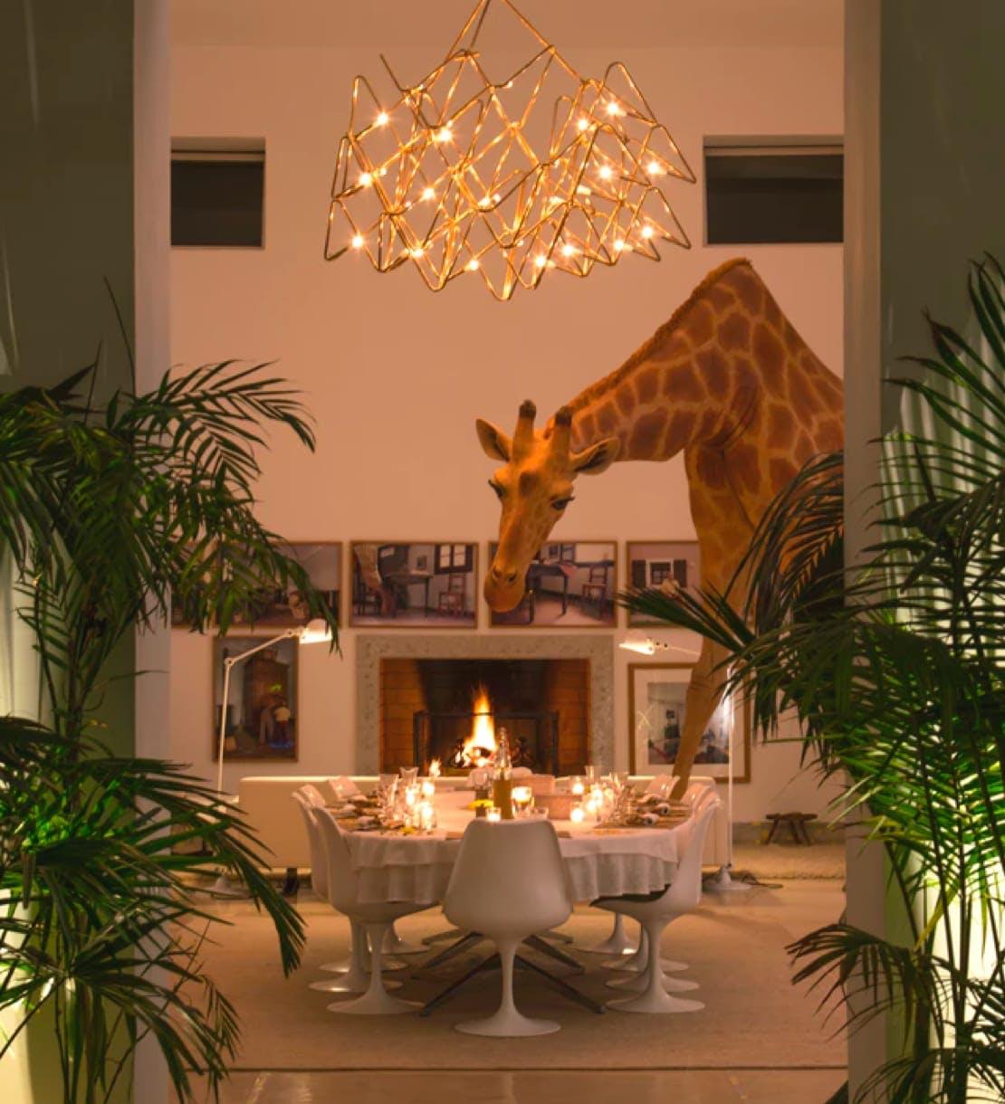 Giraffe sculpture in dining room