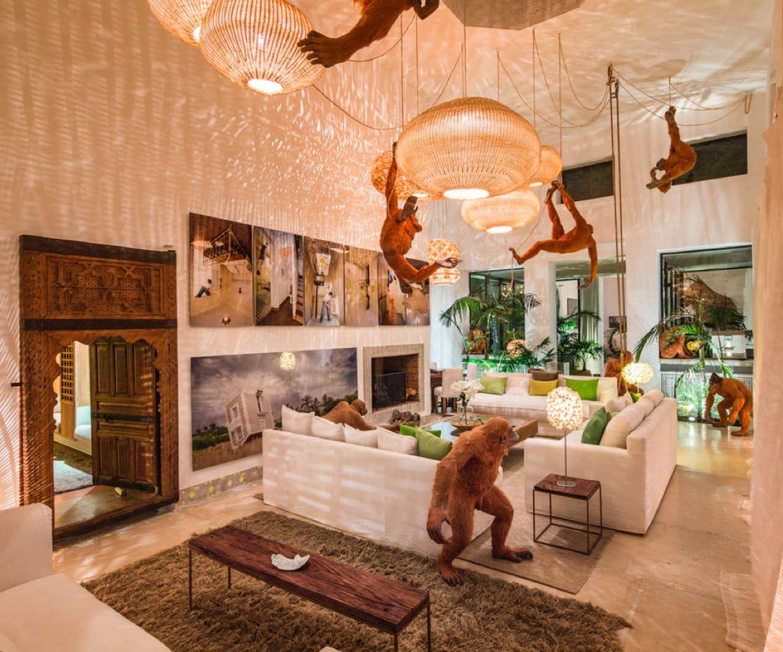 Riad with chimp sculpture in living-room